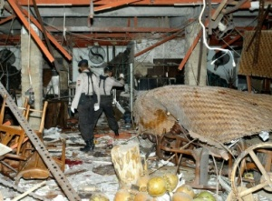 Searching for clues: Police inspect one of the restaurants that suffered the worst impact of the 2002 Bali bombings in Kuta. JP