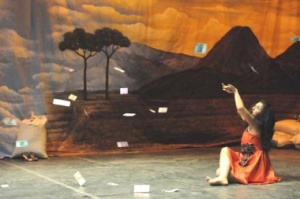 Drops of fortune: Actress Hanny Herlina looks up at money falling from the sky. Garasi actors impersonate Tarling-Dangdut performers, who in real life, receive money thrown or given to them by the audience. — Photo by courtesy of Festival Salihara