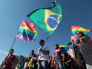Come out: People wave gay movement flags (left and right) and the Brazilian flag during a march against homophobia in Brasilia, Brazil, on May 18. AP/Eraldo Peres