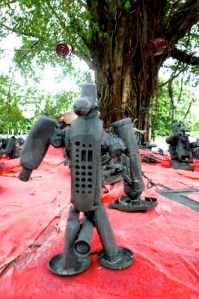 Tree monster: Toy robots made of plastic waste have been placed under a banyan tree in Theater Jakarta's open space as part of an installation by Atap Alis Community.