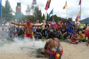 Sacred fire dance: Aboriginal men dance around a sacred fire at the 40th anniversary of Aboriginal Tent Embassy in Canberra.