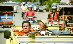 The killer: Former death-squad leader Anwar Congo (center) re-lives his savage past in The Act of Killing. (Dogwoof.com)