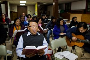 A prayer meeting at Grace Indonesia Baptist Church in Woodside, Queens. Credit Katie Orlinsky for The New York Times